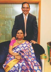 with wife Manjula Jain